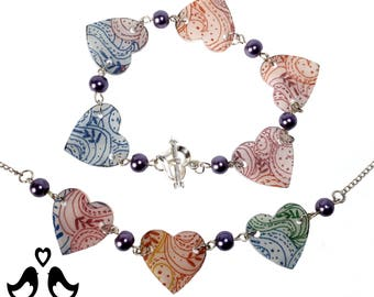Necklace and bracelet set of multicoloured handdrawn design on heart shaped tiles, one of a kind.