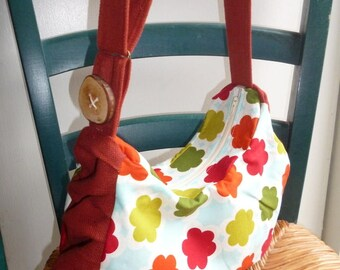 Slouchy handbag in floral print and red fabric