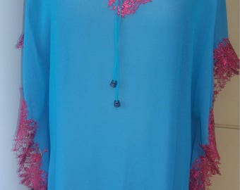 Sea blue silk caftan with guipoure lace at the edge