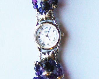 Retro Cape Amethyst Watch mother of pearl face with silver bow attachments.  Beaded band.