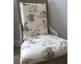 A large reupholstered Victorian nursing chair