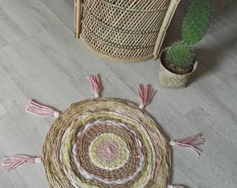 Pink round rug with tassels
