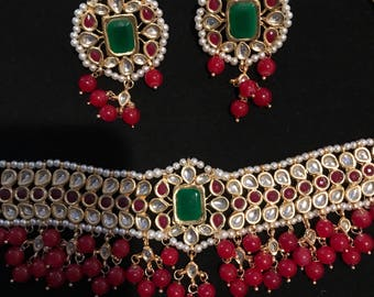 Gold finish kundan choker with green and red stones