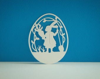 Cut carved white egg Bunny with his carrot for scrapbooking and card