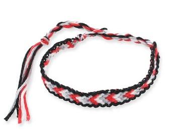 1 black, red, blue and white friendship bracelet