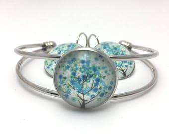 Bracelet stiff tree of life glass cabochon blue and white tone
