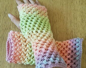 "long fingerless gloves are hand crocheted pattern ""FishNet madness"" original creation in shades of pastels"