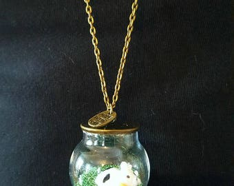 Green microbeads and cow globe necklace