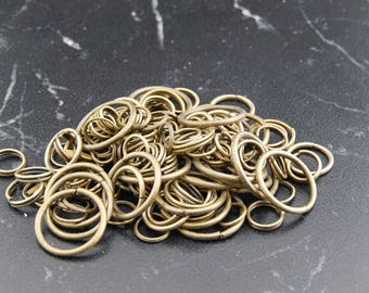 200 mixed sizes of bronze jump rings