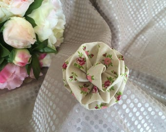beige fabric flower and small flowers