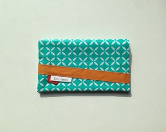 Checkbook holder in turquoise oilcloth with white geometric pattern