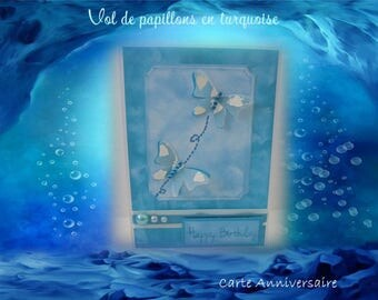 Flight of butterflies in turquoise and white