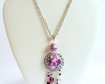 Pink flowers and silver necklace