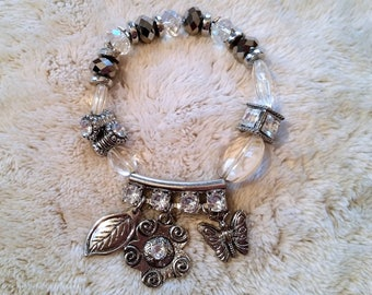 Bracelet with faceted beads and charms
