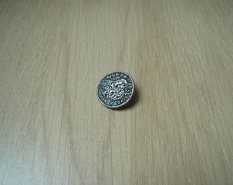 flat tail button patterned lion and inscription