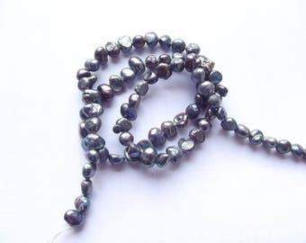 74 ZUI 152 irregular 4-5 mm iridescent grey freshwater pearls