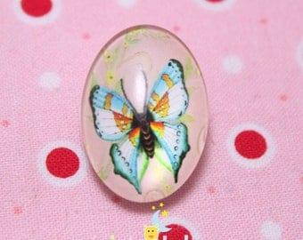 Glass cabochon oval pattern light blue butterfly 18 / 25mm