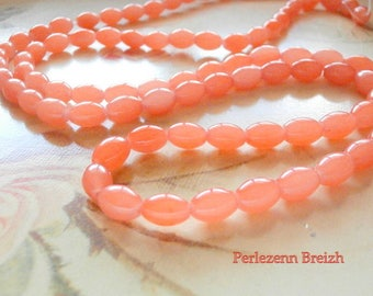 50 glass beads in coral 8x6mm oval