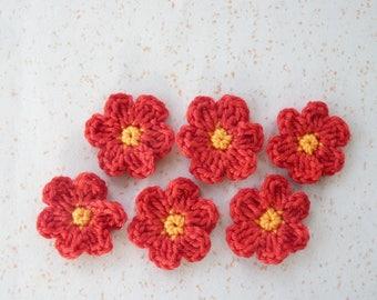 6 small red/orange crochet flowers cotton