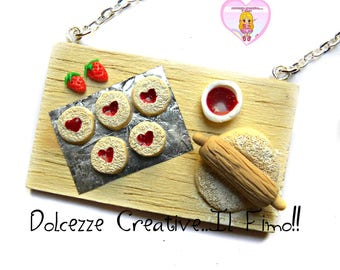 Necklace wooden tray with the preparation of heart cookies with Strawberry Jam