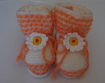 WHITE BABY BOOTIES, AND ORANGE WITH FLOWERS CROCHET.
