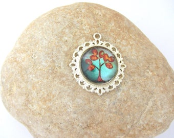 A pendant with tree red glass cabochon