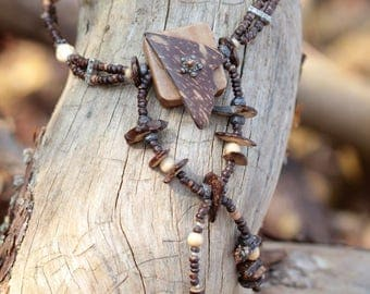 Nature necklace made of coconut and other Woods, silver metal beads