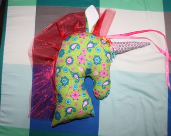 NEW - The Unicorn hanging in pink and green