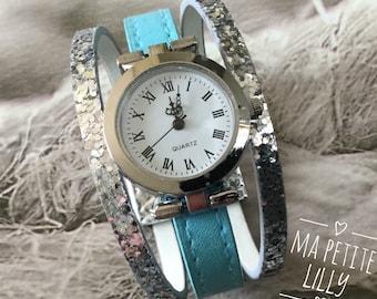 Wristwatch woman XS.  Cuff trend 2018.  shows round bracelet blue and silver glitter
