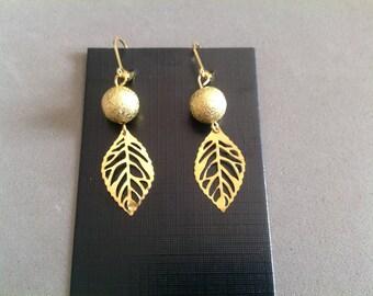 Pair of Golden dangle earrings