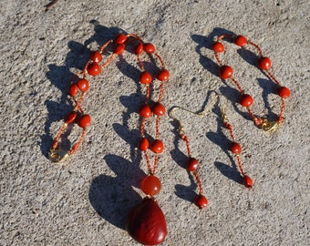 necklace, earrings and bracelet with natural seeds and a stone of carnelian necklace