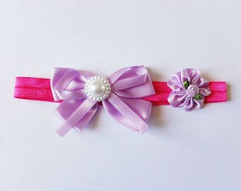 Little baby girl pink headband with a big bow and purple flower fuchsia