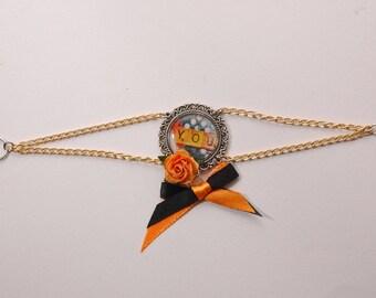 Scrabble, orange and black satin ribbon, flower bracelet