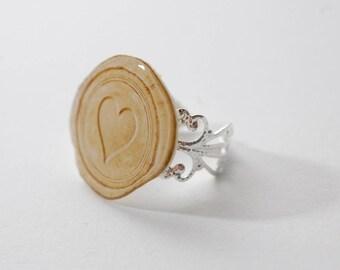 Adjustable silver filigree heart wax seal way