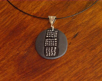 Small ethnic round polymer clay pendant