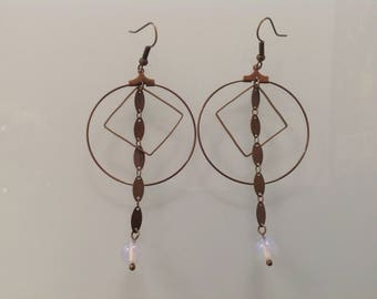 Bronze hoops and opal glass bead.