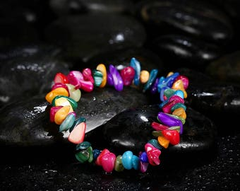 Beautiful bracelet of shell chips in the color shimmering