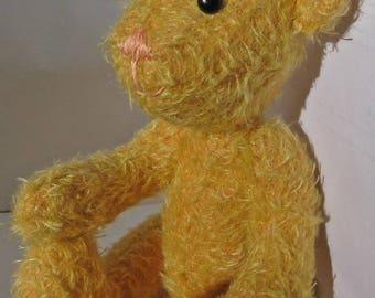 Adorable teddy bear in golden yellow fur