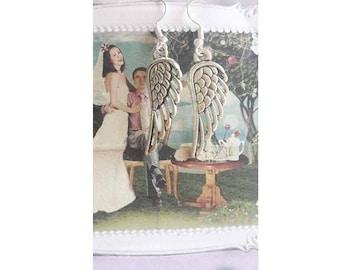 A pretty pair of earring Angel, angel wing, guardian angel
