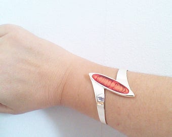 Bangle is modern, red and orange, no. 1, light collection.