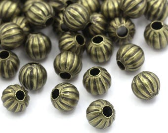 Wholesale lot of 100 round bronze metal beads, 6mm