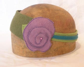 in green and purple wool flower headband