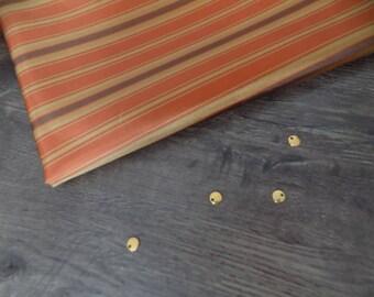 Brown/orange shiny fabric