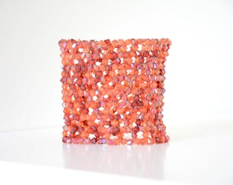 Hand woven red orange bracelet