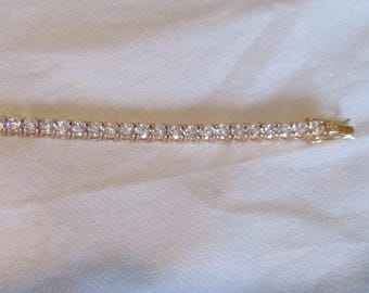 gold plated bracelet with white rhinestones