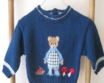 Baby sweater with bear picking mushrooms