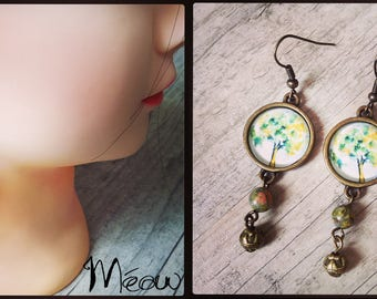 Earring in bronze and gem stone