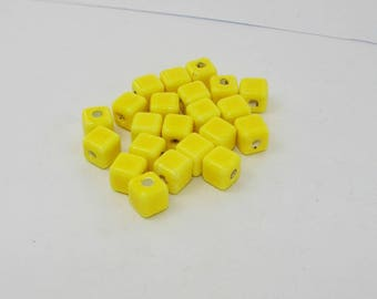 Bright yellow ceramic bead, cube 8.00 mm.