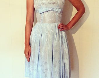 Classic 1950s couture lustrous light blue dress