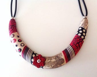 Red, black and white polymer torque necklace off